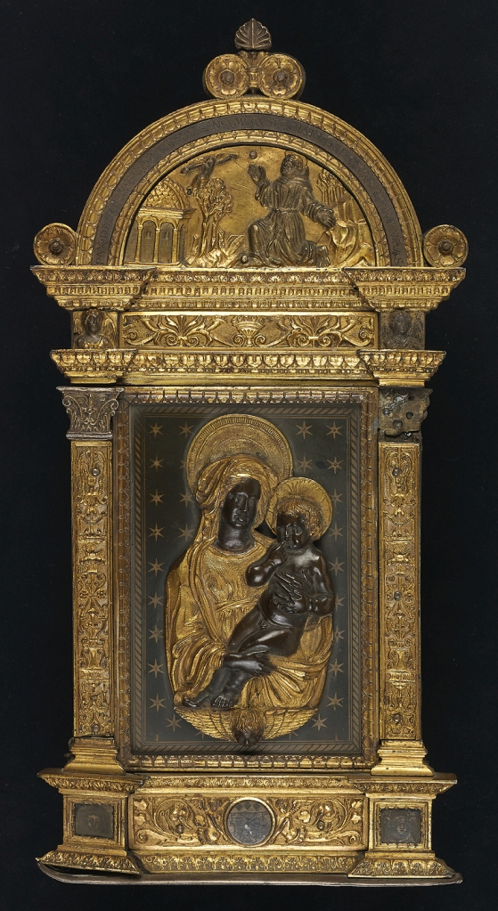 Fig. 01: A gold gilt silver and niello pax frame and lunette of St. Francis Receiving the Stigmata, anon. Florentine goldsmith, 1518; and a partially gilt copper applique of the Virgin, Child and a winged-putto-head, ca. 1445-50, here attributed to Maso di Bartolomeo or his workshop (after designs associated with Luca Della Robbia) (Kollenburg Antiquairs)